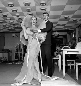 1959-Yves-Saint-Laurent-performing-Dior-couture-fitting