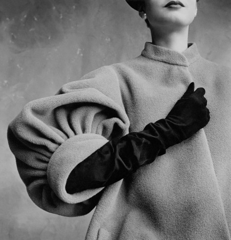 Close-up of the gathered sleeve of a coat by Balenciaga, worn with long gloves
